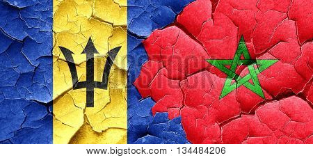 Barbados flag with Morocco flag on a grunge cracked wall