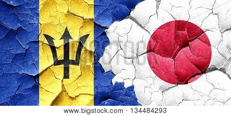 Barbados flag with Japan flag on a grunge cracked wall