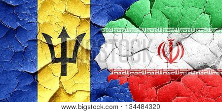 Barbados flag with Iran flag on a grunge cracked wall