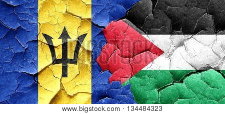Barbados flag with Palestine flag on a grunge cracked wall