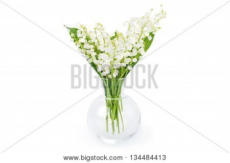 Lily of the valley spring flowers in a glass vase isolated on white background.