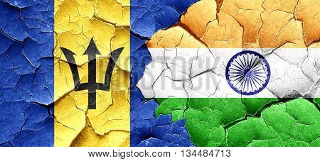 Barbados flag with India flag on a grunge cracked wall