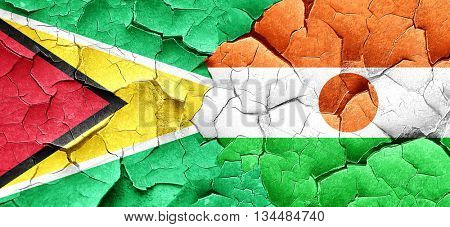 Guyana flag with Niger flag on a grunge cracked wall