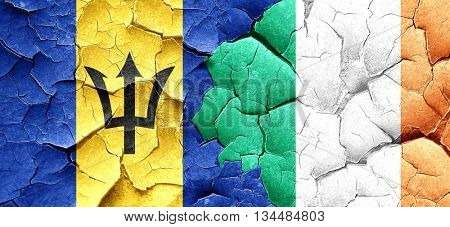 Barbados flag with Ireland flag on a grunge cracked wall