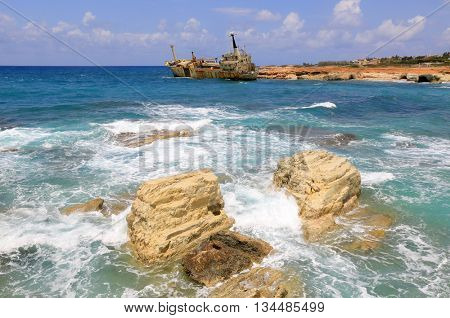 Stones in sea water on shipwreck background, Cyprus