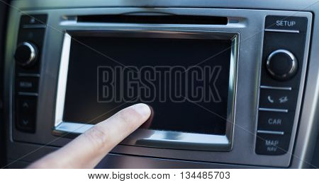 Male Hand Touching Screen In Car