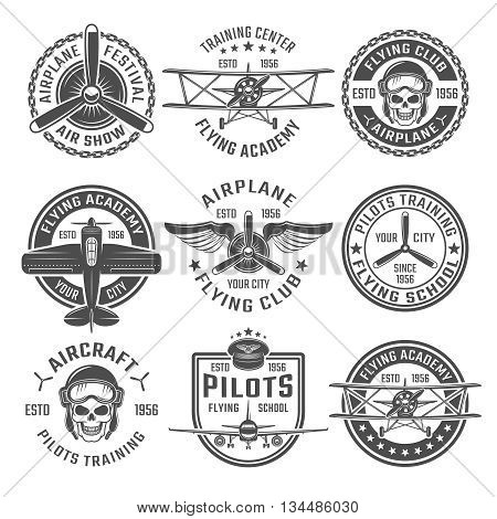 Airplane emblem or labels set with different shapes and headlines flying club flying academy and training centre for example vector illustration