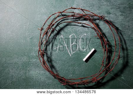 barbwire on top of blackboard