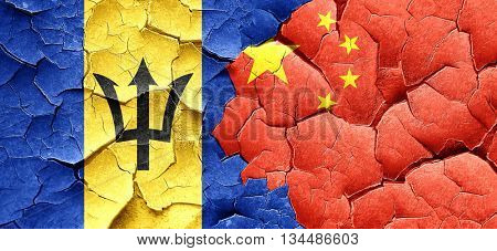 Barbados flag with China flag on a grunge cracked wall