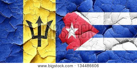 Barbados flag with cuba flag on a grunge cracked wall
