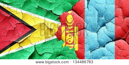 Guyana flag with Mongolia flag on a grunge cracked wall