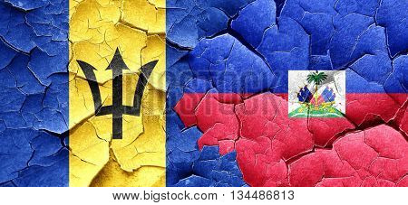 Barbados flag with Haiti flag on a grunge cracked wall
