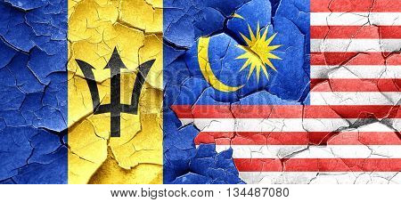 Barbados flag with Malaysia flag on a grunge cracked wall