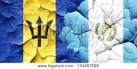Barbados flag with Guatemala flag on a grunge cracked wall