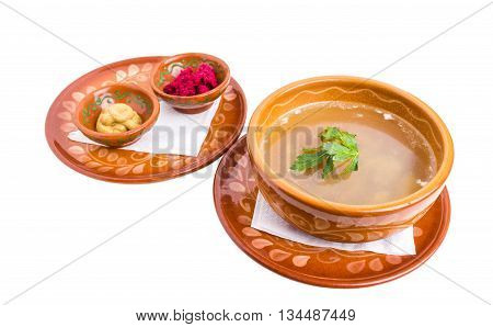 Jelly chicken in russian style with mustard and horseradish cream. Isolated on a white background.