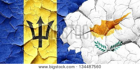 Barbados flag with Cyprus flag on a grunge cracked wall
