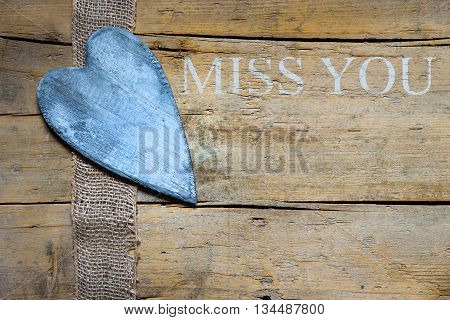 Jute Ribbon And Heart On Wooden Table, Miss You