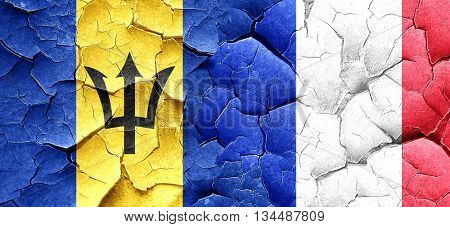Barbados flag with France flag on a grunge cracked wall