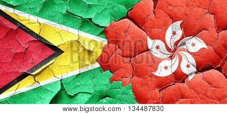 Guyana flag with Hong Kong flag on a grunge cracked wall