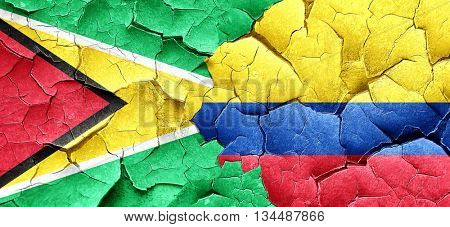 Guyana flag with Colombia flag on a grunge cracked wall