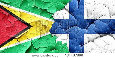 Guyana flag with Finland flag on a grunge cracked wall