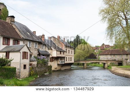 River the Auvezere with half timbered houses in Segur-le-Chateau