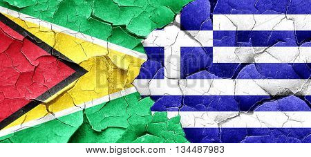 Guyana flag with Greece flag on a grunge cracked wall
