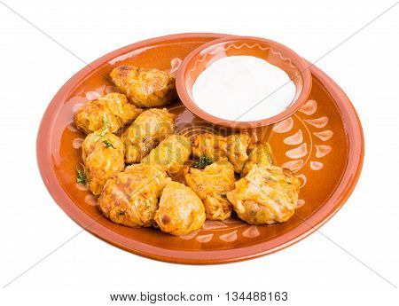 Delicious balkan dolma stuffed with rice and meat. Served with sour cream. Isolated on a white background.