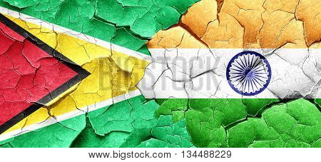 Guyana flag with India flag on a grunge cracked wall