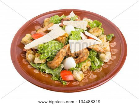 Delicious chicken caesar salad with parmesan. Isolated on a white background.