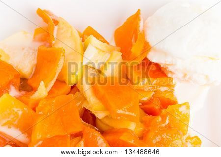 Delicious apple and peach dessert with vanilla ice cream scoop. Macro. Photo can be used as a whole background.