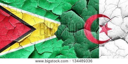 Guyana flag with Algeria flag on a grunge cracked wall