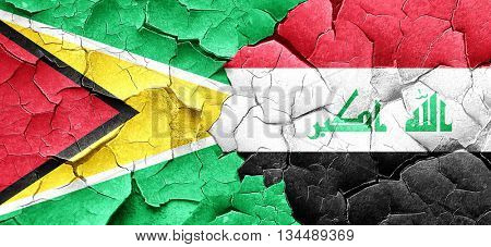 Guyana flag with Iraq flag on a grunge cracked wall