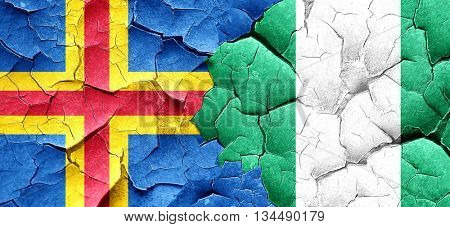 aland islands with Nigeria flag on a grunge cracked wall