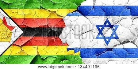 Zimbabwe flag with Israel flag on a grunge cracked wall