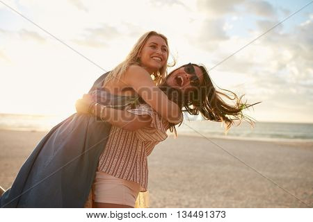 Young Women Vacationers Enjoying On The Beach