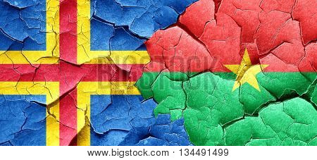 aland islands with Burkina Faso flag on a grunge cracked wall
