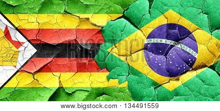 Zimbabwe flag with Brazil flag on a grunge cracked wall