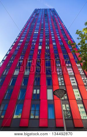 Rotterdam, Netherlands - 24 MAY 2015: Modern residential tower in Rotterdam. Named 'the red apple' designed by KCAP architects and Jan des Bouvrie