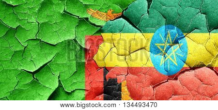Zambia flag with Ethiopia flag on a grunge cracked wall