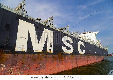 Antwerp, Belgium - 1 August 2015. Close-up of large cargo container vessel from the Mediterranean Shipping Company (MSC) in the port of Antwerp, Belgium.