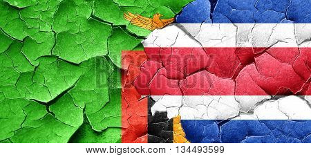 Zambia flag with Costa Rica flag on a grunge cracked wall