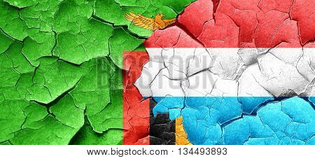 Zambia flag with Luxembourg flag on a grunge cracked wall