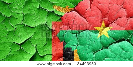 Zambia flag with Burkina Faso flag on a grunge cracked wall