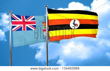 Fiji flag with Uganda flag, 3D rendering