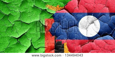 Zambia flag with Laos flag on a grunge cracked wall