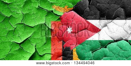 Zambia flag with Jordan flag on a grunge cracked wall
