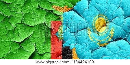 Zambia flag with Kazakhstan flag on a grunge cracked wall