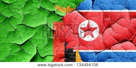 Zambia flag with North Korea flag on a grunge cracked wall