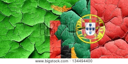 Zambia flag with Portugal flag on a grunge cracked wall